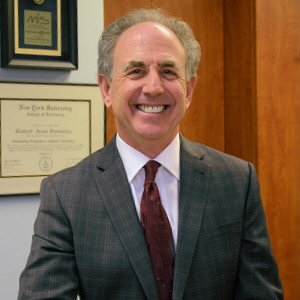 Photograph of a smiling Dr. Robert Horowitz, dressed in a suit and tie